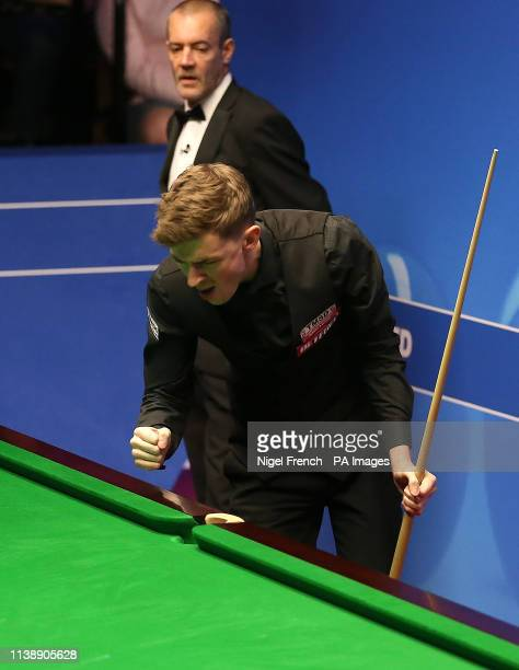 James Cahill celebrates after beating Ronnie O'Sullivan 108 during day four of the 2019 Betfred World Championship at The Crucible Sheffield