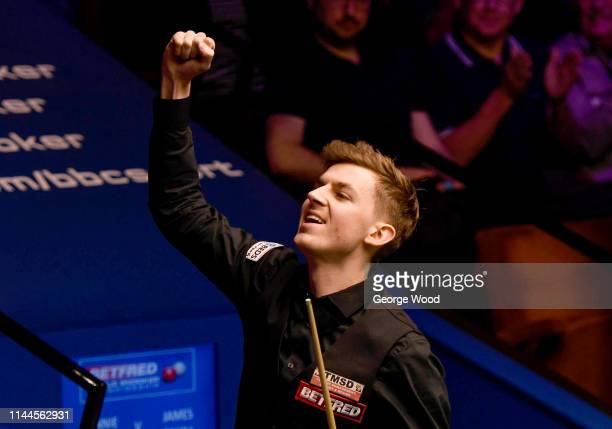 James Cahill celebrates following his win against Ronnie O'Sullivan in the opening round of the world snooker championship at Crucible Theatre on...