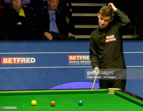 James Cahill in action against Stephen Maguire during day seven of the 2019 Betfred World Championship at The Crucible Sheffield