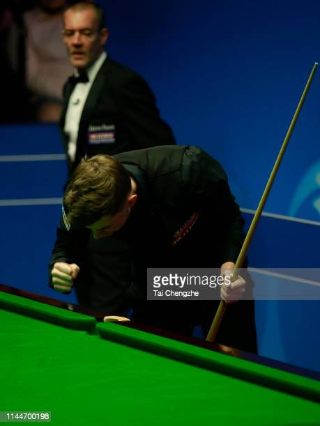 James Cahill of England celebrates after winning the first round match against Ronnie O'Sullivan of England during day four of the 2019 Betfred World...