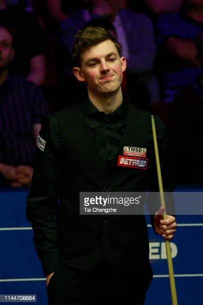 James Cahill of England reacts in the first round match against Ronnie O'Sullivan of England during day four of the 2019 Betfred World Snooker...