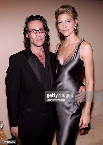 James Callis and Tricia Helfer during 57th Annual Primetime Creative Arts EMMY Awards Green Room at Shrine Auditorium in Los Angeles California...
