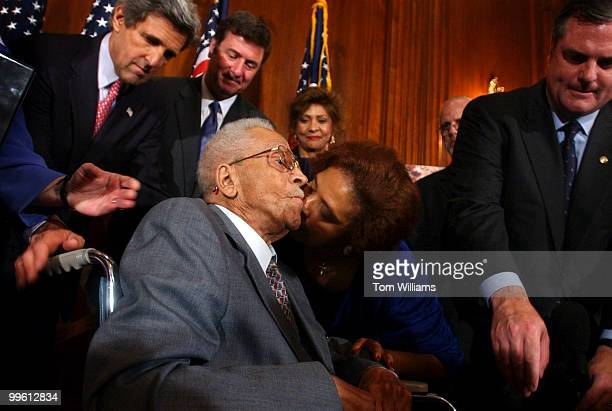 James Cameron gets a kiss from Dr E Faye Williams after Cameron recounted an episode in which he was almost lynched in 1930 in Marion Indiana Cameron...