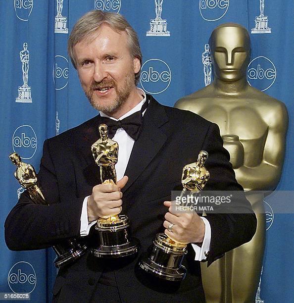 James Cameron holds the three Oscars he won for Best Fim, Best Director, and Best Editing 23 March at the 70th Annual Academy Awards at the Shrine...