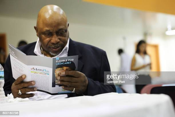 James Cammick reads literature on Medicaid at a Senior Citizens Prom sponsored by the MetroPlus a prepaid health services plan on June 23 2017 in New...