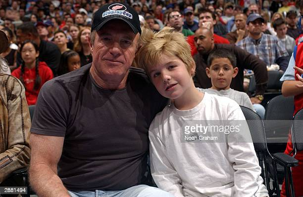James Cann with his son Jimmy at the Los Angeles Clippers game against the Sacramento Kings at Staples Center on January 19 2004 in Los Angeles...