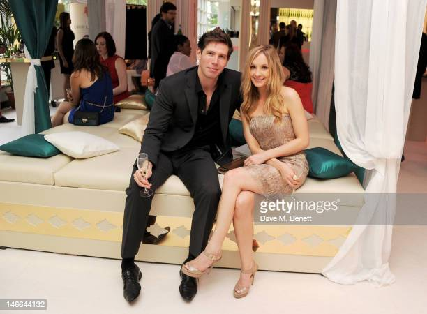 James Cannon and Joanne Froggatt attend the WTA PreWimbledon Party presented by Dubai Duty Free at Kensington Roof Gardens on June 21 2012 in London...