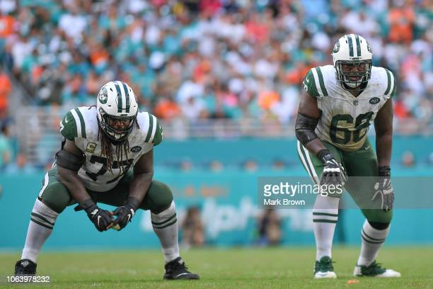 James Carpenter and Kelvin Beachum of the New York Jets line up to block during the game against the Miami Dolphins at Hard Rock Stadium on November...