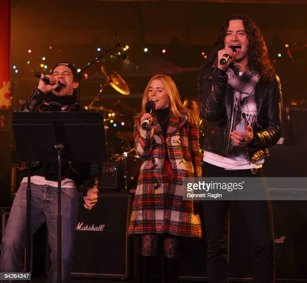 James Carpinello Amy Spanger and Constantine Maroulis perform during the holiday tree lighting at the New York Stock Exchange on December 10 2009 in...