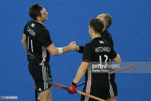 James Carson of Wales celebrates with his teammates after scoring during the FIH Series Finals for 4th and 5th placing match between China and Wales...