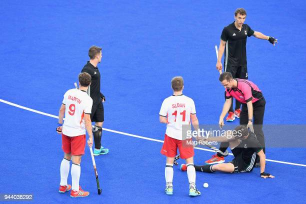 James Carson of Wales is struck by the ball during the Hockey Men's Pool B match between England and Wales on day six of the Gold Coast 2018...