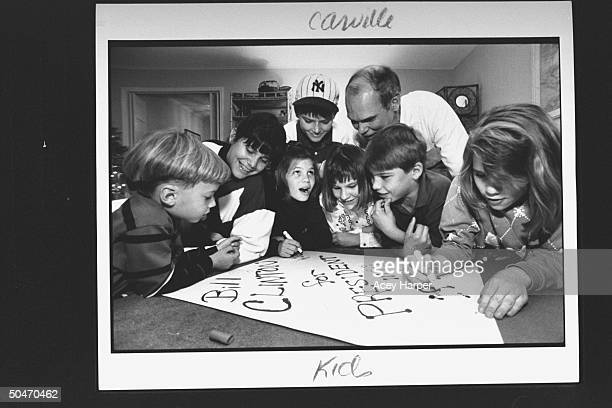 James Carville pol consultant for Dem Pres cand Bill Clinton supervising the work of his young nieces nephews as they make up a BILL CLINTON FOR...