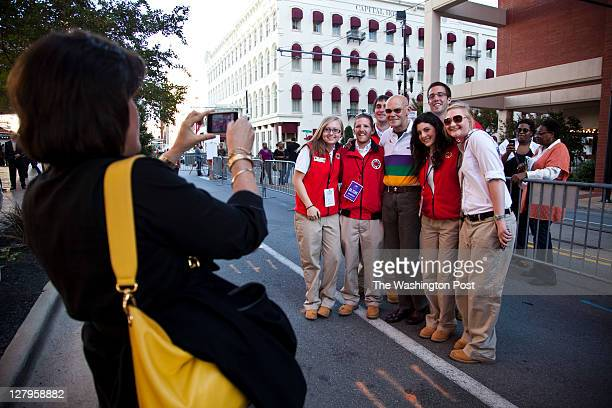James Carville the political strategist who worked on Clinton's 1992 campaign poses for photos with a public service group after Clinton's address to...