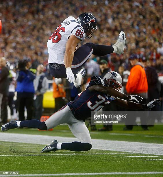 James Casey of the Houston Texans attempts to hurdle Devin McCourty of the New England Patriots after catching a pass during the game at Gillette...