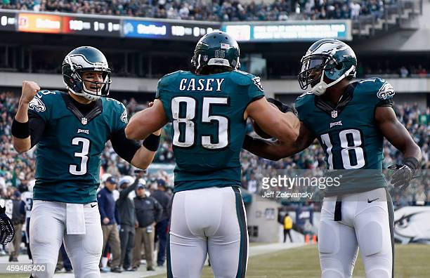 James Casey of the Philadelphia Eagles celebrates a touchdown with teammates Mark Sanchez and Jeremy Maclin against the Tennessee Titans during the...