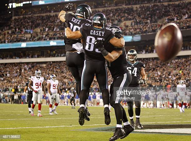 James Casey of the Philadelphia Eagles celebrates his touchdown catch against the New York Giants with teammates Zach Ertz and Brent Celek during the...