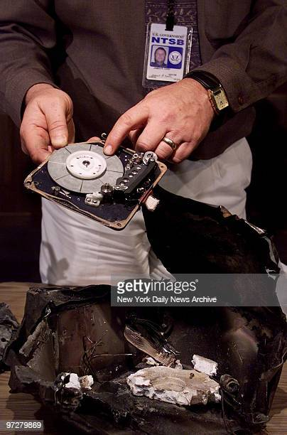 James Cash Chief of the Vehicle Recorder Division of the National Transportation and Safety Board holds a reel from the cockpit voice recorder of...