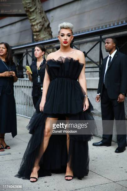 James Charles arrives at the Marc Jacobs show during New York Fashion Week wearing a black dress and heels on September 11, 2019 in New York City.