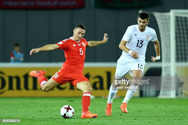James Chester and Giorgi Kvilitaia of Georgia in action during the FIFA 2018 World Cup Qualifier between Georgia and Wales at Boris Paichadze Dinamo...