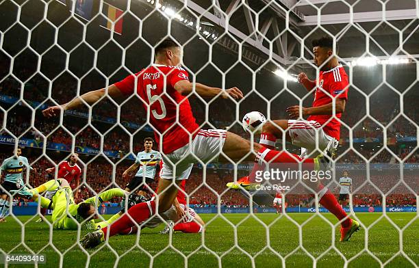 James Chester and Neil Taylor of Wales block the shot during the UEFA EURO 2016 quarter final match between Wales and Belgium at Stade Pierre-Mauroy...
