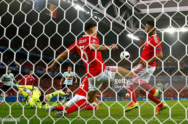 James Chester and Neil Taylor of Wales block the shot off teh goal line during the UEFA EURO 2016 quarter final match between Wales and Belgium at...