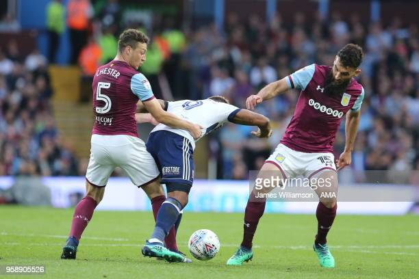 James Chester of Aston Villa and Britt Assombalonga of Middlesbrough and Mile Jedinak of Aston Villa during the Sky Bet Championship Play Off Semi...