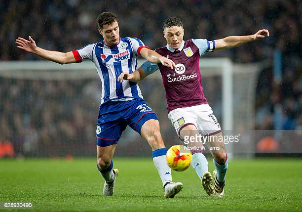 James Chester of Aston Villa ash challenged by Yanic Wildschut of Wigan Athletic during the Sky Bet Championship match between Aston Villa and Wigan...