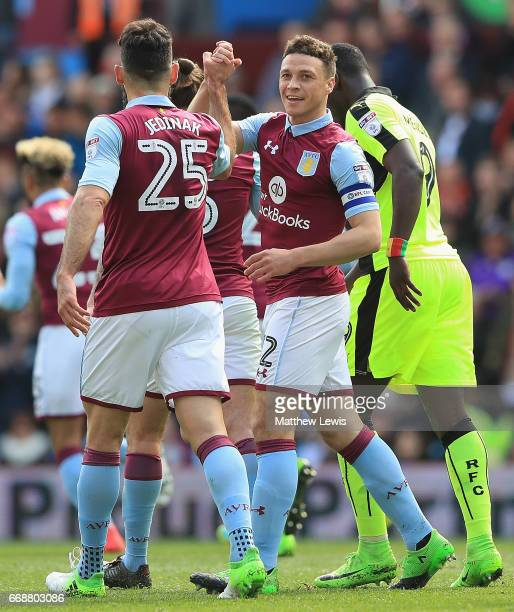 James Chester of Aston Villa celebrates his goal with team mate Mile Jedinak during the Sky Bet Championship match between Aston Villa and Reading at...