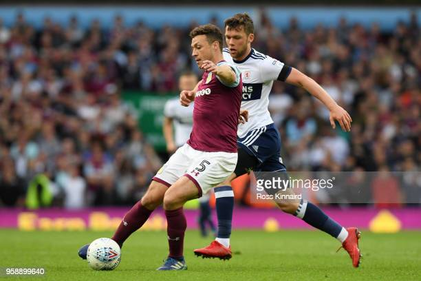 James Chester of Aston Villa controls the ball as Jonny Howson of Middlesbrough chases during the Sky Bet Championship Play Off Semi Final second leg...
