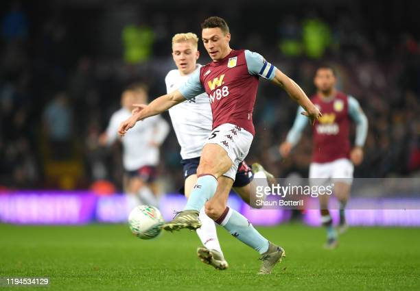 James Chester of Aston Villa controls the ball under pressure from Luis Longstaff of Liverpool during the Carabao Cup Quarter Final match between...