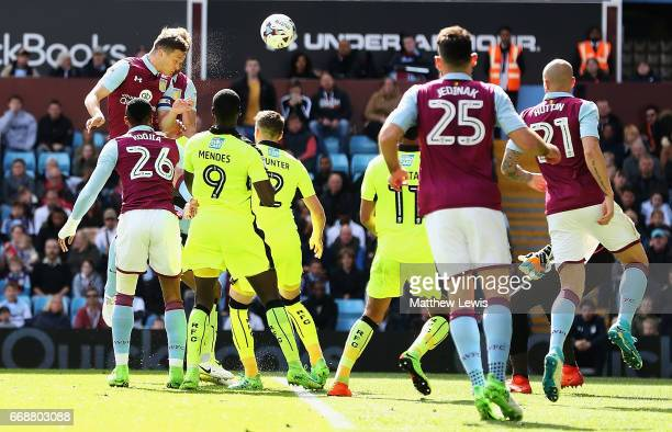 James Chester of Aston Villa heads the ball to score a goal during the Sky Bet Championship match between Aston Villa and Reading at Villa Park on...