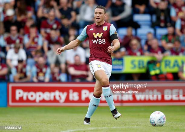 James Chester of Aston Villa passes the ball during the PreSeason Friendly match between Shrewsbury Town and Aston Villa at Montgomery Waters Meadow...