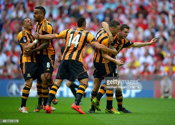 James Chester of Hull City celebrates scoring the opening goal his team mates during the FA Cup with Budweiser Final match between Arsenal and Hull...