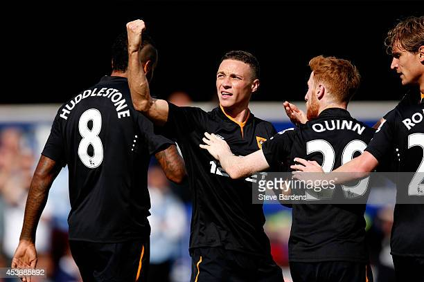 James Chester of Hull City celebrates scoring the opening goal against Queens Park Rangers with teammates lr Tom Huddlestone Stephen Quinn and Nikica...