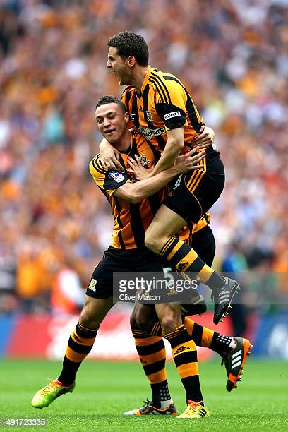 James Chester of Hull City celebrates with team mate Alex Bruce as he scores their first goal during the FA Cup with Budweiser Final match between...