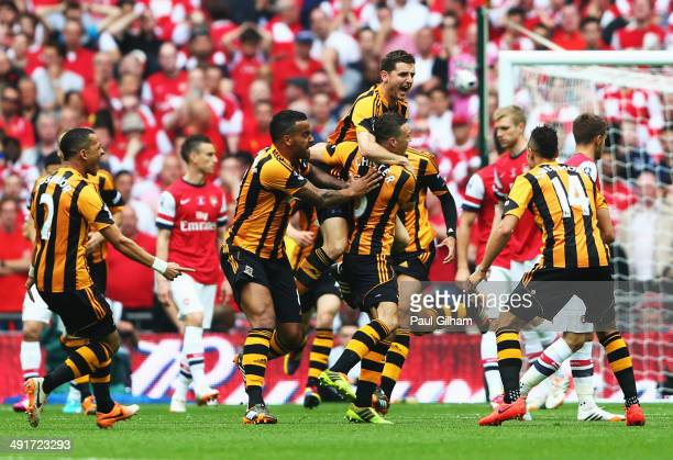 James Chester of Hull City celebrates with team mates as he scores their first goal during the FA Cup with Budweiser Final match between Arsenal and...