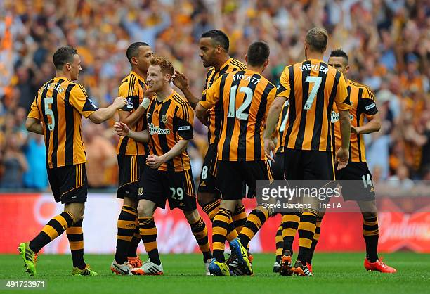 James Chester of Hull City celebrates with team-mates after scoring the opening goal during the FA Cup with Budweiser Final match between Arsenal and...