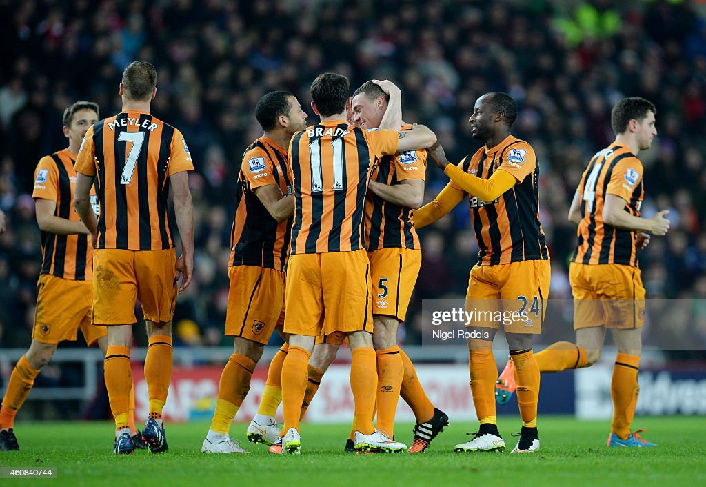 James Chester #5 of Hull City is congratulated by teammates after scoring a goal to give his team a 2-1 lead during the Barclays Premier League match between Sunderland and Hull City at the Stadium of Light on December 26, 2014 in Sunderland, England.