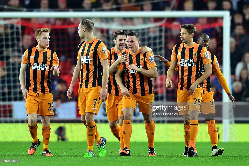 James Chester #5 (c) of Hull City is congratulated by teammates after scoring a goal to give his team a 2-1 lead during the Barclays Premier League match between Sunderland and Hull City at the Stadium of Light on December 26, 2014 in Sunderland, England.