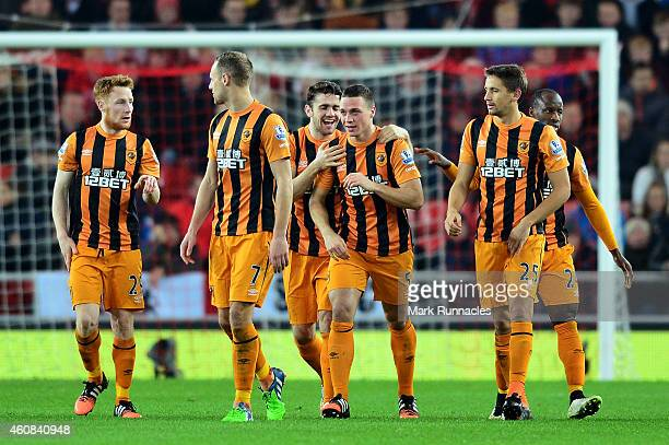James Chester of Hull City is congratulated by teammates after scoring a goal to give his team a 21 lead during the Barclays Premier League match...