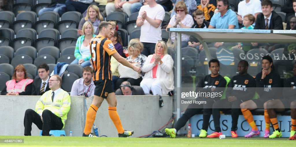James Chester of Hull City is sent off by referee J. Moss during the Barclays Premier League match between Hull City and Stoke City at the KC Stadium on August 24, 2014 in Hull, England.