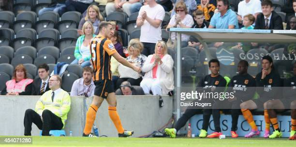 James Chester of Hull City is sent off by referee J Moss during the Barclays Premier League match between Hull City and Stoke City at the KC Stadium...