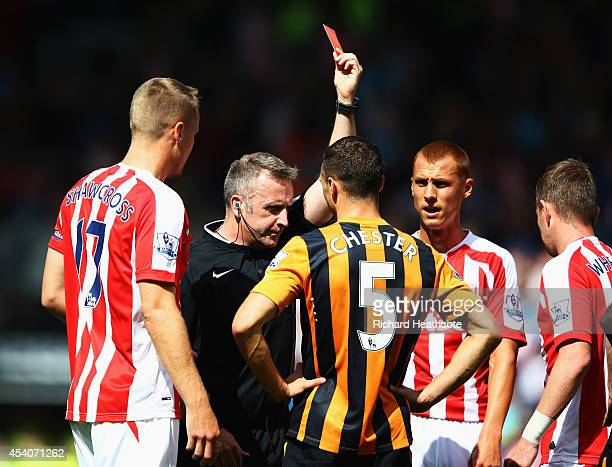 James Chester of Hull City is show a red card by referee Jonathan Moss and is sent off during the Barclays Premier League match between Hull City and...