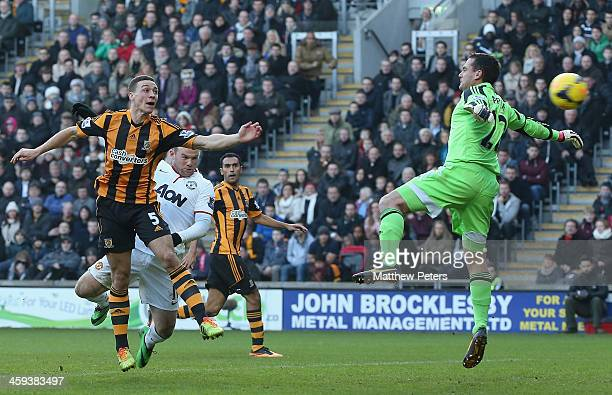 James Chester of Hull City scores an own goal during the Barclays Premier League match between Hull City and Manchester United at KC Stadium on...