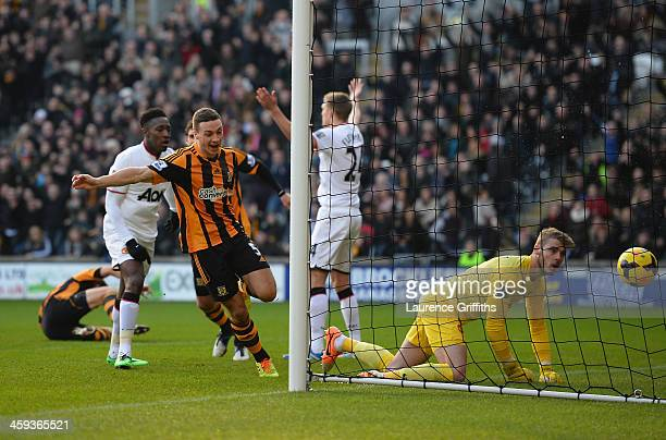 James Chester of Hull City scores the opening goal past David De Gea of Manchester United during the Barclays Premier League match between Hull City...