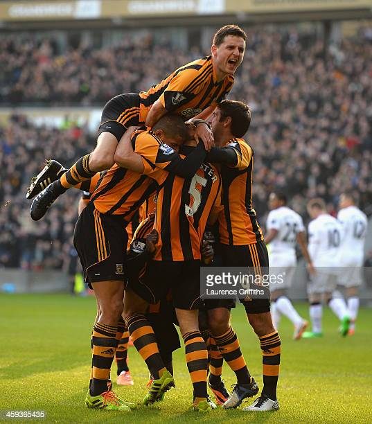 James Chester of Hull Cityis mobbed after scoring the opening goal during the Barclays Premier League match between Hull City and Manchester United...