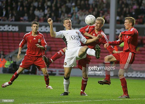 James Chester of Manchester United clashes with Robbie Threlfall and Stephen Darby of Liverpool during the FA Youth Cup Final first leg match between...