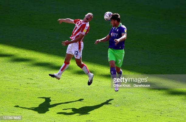 James Chester of Stoke City and Chris Martin of Bristol City in action during the Sky Bet Championship match between Stoke City and Bristol City at...
