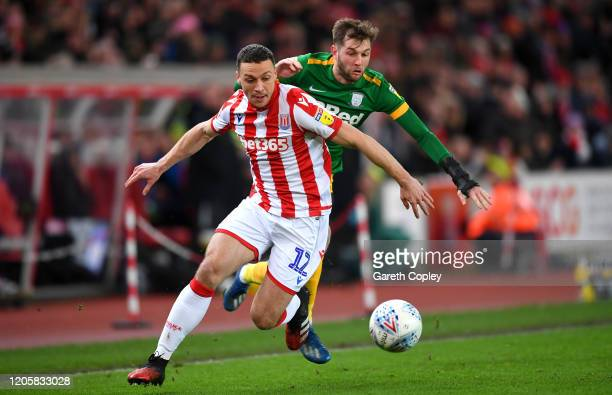 James Chester of Stoke City is challenged by Tom Barkhuizen of Preston North End during the Sky Bet Championship match between Stoke City and Preston...
