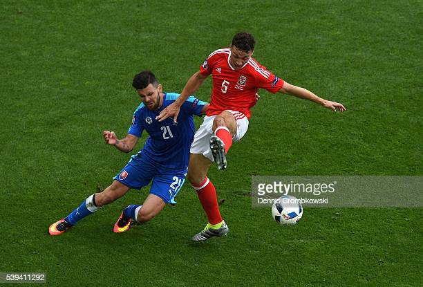 James Chester of Wales and Michal Duris of Slovakia compete for the ball during the UEFA EURO 2016 Group B match between Wales and Slovakia at Stade...